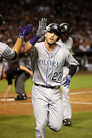 Trevor Story hits the first of two homeruns in his Major League debut for the Colorado Rockies against the Arizona Diamondbacks at Chase Field on April 4, 2016 in Phoenix, Arizona (Bill Mitchell)