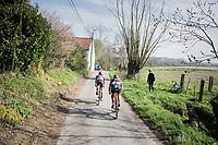 teammates Marco Coledan (ITA/Trek-Segafredo) & Fumy Beppu (JAP/Trek-Segafredo) chasing on the narrow belgian farm roads<br /> <br /> 60th E3 Harelbeke (1.UWT)<br /> 1day race: Harelbeke › Harelbeke - BEL (206km)