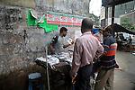 A young Indian boy selling pirated CD on a foot path in Kolkata, West Bengal,  India  7/18/2007.  Arindam Mukherjee/Landov