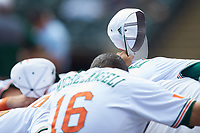 The Miami Hurricanes huddle up prior to the game against the Georgia Tech Yellow Jackets during game one of the 2017 ACC Baseball Championship at Louisville Slugger Field on May 23, 2017 in Louisville, Kentucky. The Hurricanes walked-off the Yellow Jackets 6-5 in 13 innings. (Brian Westerholt/Four Seam Images)