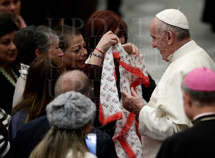 A woman donates a neckerchief to Pope Francis at the end of the weekly general audience in Paul VI hall at the Vatican on November 30, 2016. UPDATE IMAGES PRESS/Isabella Bonotto<br /> <br /> STRICTLY ONLY FOR EDITORIAL USE