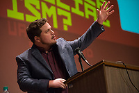 "Seawolf debator Robert Hockema takes the podium during an exhibition debate between UAA and Stanford University at Loussac Library's Wilda Marston Theater. UAA's debate team, consisting of Hockema and John Macy, bested Stanford's, arguing the pro on the night's question ""Is America Ready for Socialism?"""