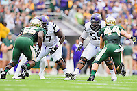 TCU nose tackle Jamelle Naff (77) and offensive tackle Tayo Fabuluje (59) step back as Baylor defensive end K.J. Smith (56) and linebacker Bryce Hager (44) attempt pass rush on the line of scrimmage during an NCAA football game, Saturday, October 11, 2014 in Waco, Tex. Baylor defeated TCU 61-58 to remain undefeated in BIG 12 conference. (Mo Khursheed/TFV Media via AP Images)