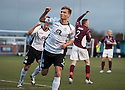 Queen of the South's Gavin Reilly celebrates after he scores their first goal.