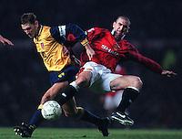 Pix:Michael Steele/SWpix...Soccer. Manchester United v Arsenal...COPYRIGHT PICTURE>>SIMON WILKINSON..Arsenals Tony Adams and Manchesters Uniteds Eric Cantona.