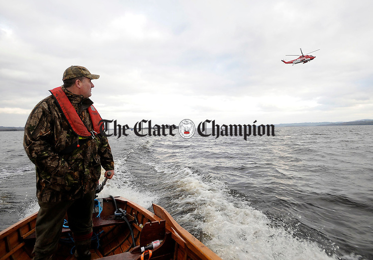 Eamon Ginlin watching the Shannon based Coast Guard helicopter over Scariff.Pic Arthur Ellis.