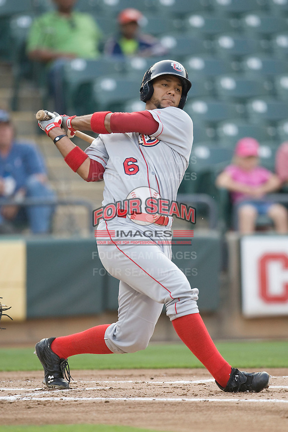Catcher Carlos Corporan #6 of the Oklahoma City RedHawks swings against the Round Rock Express on April 26, 2011 at the Dell Diamond in Round Rock, Texas. (Photo by Andrew Woolley / Four Seam Images)