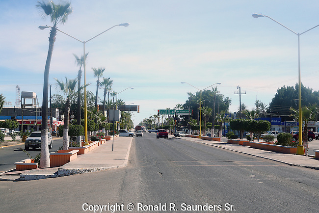 QUIET MEXICAN STREET SCENE.<br /> <br /> Ciudad Constitución is a city in the Mexican state of Baja California Sur. Ciudad Constitución's population was 40,935 inhabitants at the 2010 census. It is the fifth-largest community in the state (behind La Paz, San José del Cabo, Cabo San Lucas, and Colonia del Sol). Ciudad Constitución is a small city which serves as a gateway to Magdalena Bay. It is also close to the Baja 1000 course.