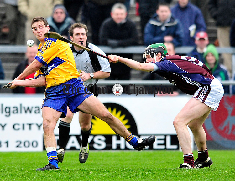 Clares Brian O'Connell under pressure from Galways Kevin Hynes at Pearse Stadium.Pic Arthur Ellis.