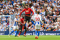 Marouane Fellaini of Manchester United (27) and Gaetan Bong of Brighton & Hove Albion (3) challenge for the ball  during the Premier League match between Brighton and Hove Albion and Manchester United at the American Express Community Stadium, Brighton and Hove, England on 19 August 2018. Photo by Edward Thomas / PRiME Media Images.