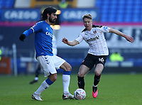 9th January 2021; Goodison Park, Liverpool, Merseyside, England; English FA Cup Football, Everton versus Rotherham United; Andre Gomes of Everton passes the ball under pressure from Jamie Lindsay of Rotherham United