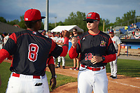 Batavia Muckdogs manager Mike Jacobs (28) fist bumps Marcos Rivera (8) during introductions before a game against the Auburn Doubledays on June 19, 2017 at Dwyer Stadium in Batavia, New York.  Batavia defeated Auburn 8-2 in both teams opening game of the season.  (Mike Janes/Four Seam Images)
