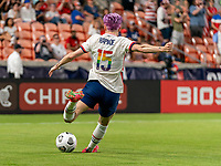 HOUSTON, TX - JUNE 10: Megan Rapinoe #15 of the USWNT crosses the ball during a game between Portugal and USWNT at BBVA Stadium on June 10, 2021 in Houston, Texas.