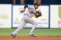 Brevard County Manatees  second baseman Yadiel Rivera (13) fields a ground ball during a game against the Lakeland Flying Tigers on April 10, 2014 at Joker Marchant Stadium in Lakeland, Florida.  Lakeland defeated Brevard County 6-5.  (Mike Janes/Four Seam Images)