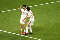 SARANSK, RUSSIA - June 25, 2018: Mehdi Taremi of Iran reacts to missing a goal against Portugal while teammate Sardar Azmoun consoles him during their 2018 FIFA World Cup group stage match at Mordovia Arena. He missed just wide.