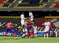 PASTO-COLOMBIA, 28-02-2021: Jeison Medina de Deportivo Pasto y Rodrigo Ureña, Marlon Torres de America de Cali disputan el balon, durante partido de la fecha 10 entre Deportivo Pasto y America de Cali por la Liga BetPlay DIMAYOR I 2021 jugado en el estadio Departamental Libertad de la ciudad de Pasto. / Jeison Medina of Deportivo Pasto and Rodrigo Ureña, Marlon Torres of America de Cali figth for the ball, during a match of the 10th date between Deportivo Pasto and America de Cali for the BetPlay DIMAYOR I 2021 League played at the Departamental Libertad Stadium in Pasto city. / Photo: VizzorImage / Leonardo Castro / Cont.