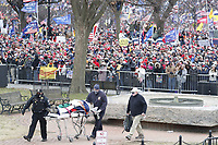 A person is removed on a stretche as US President Donald J. Trump delivers remarks to supporters gathered to protest Congress' upcoming certification of Joe Biden as the next president on the Ellipse in Washington, DC, USA, 06 January 2021. Various groups of Trump supporters are gathering to protest as Congress prepares to meet and certify the results of the 2020 US Presidential election.<br /> CAP/MPI/RS<br /> ©RS/MPI/Capital Pictures