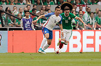 Mexico City, Mexico - Sunday June 11, 2017: Bobby Wood, Héctor Herrera during a 2018 FIFA World Cup Qualifying Final Round match with both men's national teams of the United States (USA) and Mexico (MEX) playing to a 1-1 draw at Azteca Stadium.
