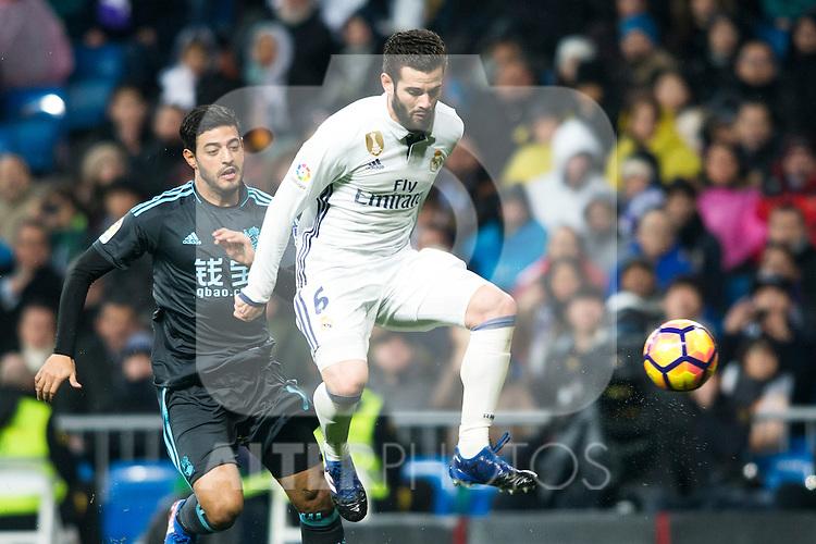 Real Sociedad's forward Carlos Vela and Real Madrid's defender Nacho Fernandez during the match of La Liga between Real Madrid and   Real Sociedad at Santiago Bernabeu Stadium in Madrid, Spain. January 29th 2017. (ALTERPHOTOS/Rodrigo Jimenez)