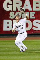 Spiker Helms (9) of the Missouri State Bears catches a ball hit to center field during a game against the Purdue Boilermakers at Hammons Field on March 13, 2012 in Springfield, Missouri. (David Welker / Four Seam Images)