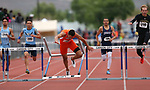 Bishop Gorman's Jake Phillips crashes in the final stretch of the 4A 300 hurdles at the NIAA Track & Field Championships at Carson High in Carson City, Nev., on Friday, May 18, 2018. Cathleen Allison/Las Vegas Review-Journal