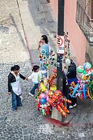Antigua, Guatemala.  Balloon Vendor in front of Church of San Jose.