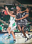 North Texas Mean Green guard Kasondra Foreman (21) and Troy Trojans guard Sophie Kleeman (2) in action during the game between the Troy Trojans and the University of North Texas Mean Green at the North Texas Coliseum,the Super Pit, in Denton, Texas. UNT defeats Troy 57 to 36.....