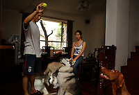July 16, 2006.Nicole and her boyfriend are good friends with John Zhao & his dog Jacky.(+86 139 0220 8347)... They are friends because they are all dog lovers... For example, John doesn't even know that Nicole lives with her parents until I bring it up. John is in charge of HR at Avon where Nicole used to work.  His life is arranged around his dog... He and his wife do not have children... the furniture is simple so it can be destroyed... they have a dog nanny (young woman in photos) to take care of the dog and clean up after them... And John has designed portable dog training equipment and he is showing Nicole and boyfriend a video of the last meet where the dog goes thru hoops and various doggie boot camp kind of tests..