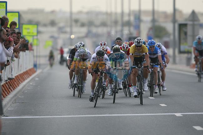 World Champion Mark Cavendish (GBR) Sky Procycling and yellow jersey holder Tom Boonen (BEL) Omega Pharma-Quick Step fight it out as they approach the finish line at the end of Stage 3 of the 2012 Tour of Qatar running 146.5km from Dukhan Souq, Dukhan to Al Gharafa, Qatar. 7th February 2012.<br /> (Photo Eoin Clarke/Newsfile)