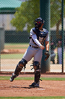AZL Indians Red catcher Yainer Diaz (4) throws to third base after a strikeout during an Arizona League game against the AZL Indians Blue on July 7, 2019 at the Cleveland Indians Spring Training Complex in Goodyear, Arizona. The AZL Indians Blue defeated the AZL Indians Red 5-4. (Zachary Lucy/Four Seam Images)