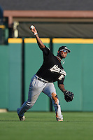 San Antonio Missions outfielder Rymer Liriano (23) throws home after catching a fly ball during a game against the Arkansas Travelers on May 25, 2014 at Dickey-Stephens Park in Little Rock, Arkansas.  Arkansas defeated San Antonio 3-1.  (Mike Janes/Four Seam Images)