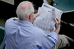 Fan reviews Belmont Stake picks on Belmont Stakes Day at Belmont Park in Elmont, NY on 06/09/12. (Ryan Lasek/ Eclipse Sportswire)