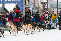Kristy Berington and team leave the ceremonial start line with an Iditarider and handler at 4th Avenue and D street in downtown Anchorage, Alaska on Saturday March 7th during the 2020 Iditarod race. Photo copyright by Cathy Hart Photography.com