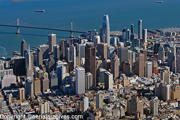 aerial photograph San Francisco financial district skyline, San Francisco, California; the TransAmerica Pyramid, left, 555 California St formerly known as the Bank of America tower, center and the Salesforce Tower, right