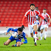 6th February 2021; Bet365 Stadium, Stoke, Staffordshire, England; English Football League Championship Football, Stoke City versus Reading; Jordan Cousins of Stoke City chases a loose ball