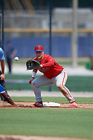 Philadelphia Phillies first baseman Rudy Rott (14) stretches for a throw during an Instructional League game against the Toronto Blue Jays on September 27, 2019 at Englebert Complex in Dunedin, Florida.  (Mike Janes/Four Seam Images)