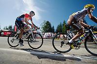 Fränk Schleck (LUX/Trek Factory Racing) in Jean-Christophe Pérauds (FRA/Ag2r-La Mondiale) wheel up the final climb to Chamrousse (1730m/18.2km/7.3%)<br /> <br /> 2014 Tour de France<br /> stage 13: Saint-Etiènne - Chamrousse (197km)