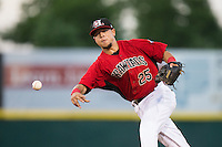 Hickory Crawdads second baseman Carlos Arroyo (25) makes a throw to first base against the Savannah Sand Gnats at L.P. Frans Stadium on June 15, 2015 in Hickory, North Carolina.  The Crawdads defeated the Sand Gnats 4-1.  (Brian Westerholt/Four Seam Images)