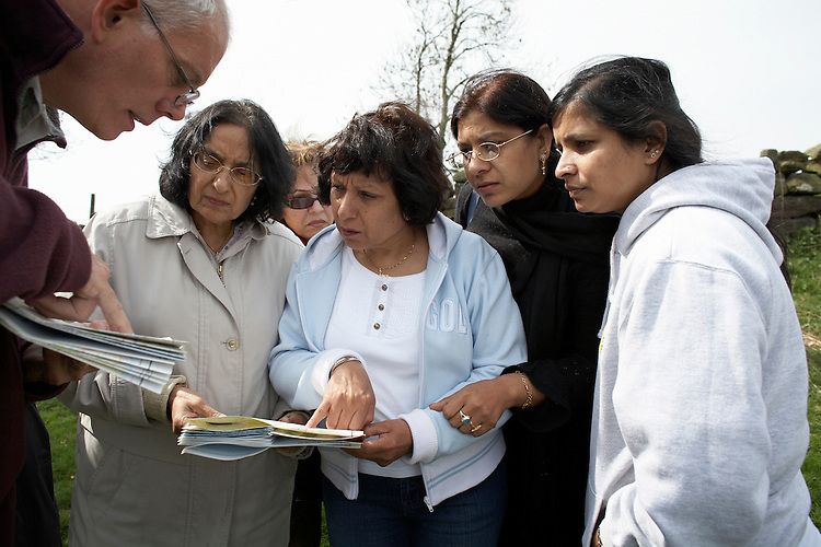 © John Angerson - Members of the Asian community in Northern England Walking in the 'Countryside Skills Day in the North York Moors ' .Head of Country park Bernie McLinden show how to read maps.