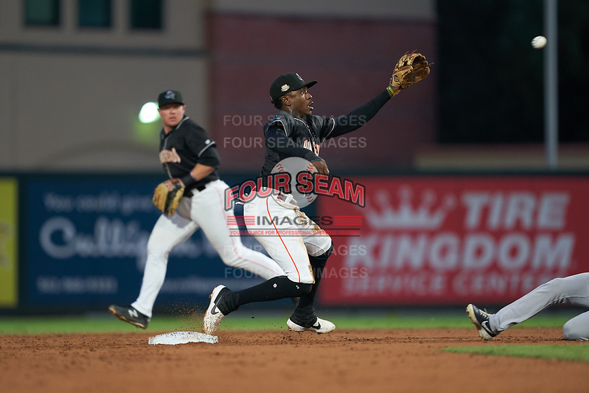 Jupiter Hammerheads shortstop Demetrius Sims (5) stretches for a throw as second baseman Gunnar Schubert (12) backs up the play during a Florida State League game against the Lakeland Flying Tigers on August 12, 2019 at Roger Dean Chevrolet Stadium in Jupiter, Florida.  Jupiter defeated Lakeland 9-3.  (Mike Janes/Four Seam Images)