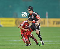 Matias Laba (20) of Toronto FC gets fouled by Chris Korb (22) of D.C. United. Toronto FC defeated D.C. United 2-1, at RFK Stadium, Saturday June 15 , 2013.