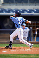 Charlotte Stone Crabs designated hitter David Olmedo-Barrera (15) follows through on a swing during a game against the Lakeland Flying Tigers on April 16, 2017 at Charlotte Sports Park in Port Charlotte, Florida.  Lakeland defeated Charlotte 4-2.  (Mike Janes/Four Seam Images)