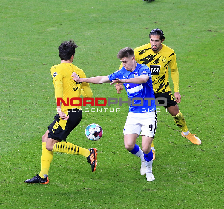 21.11.2020, OLympiastadion, Berlin, GER, DFL, 1.FBL, Hertha BSC VS. Borussia Dortmund, <br /> DFL  regulations prohibit any use of photographs as image sequences and/or quasi-video<br /> im Bild Krzysztof Piatek (Hertha BSC Berlin #9),<br /> Mats Hummels (Borussia Dortmund #15), Emre Can (Borussia Dortmund #23)<br /> <br />       <br /> Foto © nordphoto / Engler