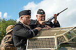 Sitting on top of an Sd.Kfz 222 reconnaissance vehicle<br /> re-enactors portraying troops from the Hermann Goering division prepare to take part in a Battle Re-enactment at the 7 Lakes Country Park 1940's weekend<br /> <br />   24/25 September 2016<br />   Copyright Paul David Drabble<br />   www.pauldaviddrabble.photoshelter.com