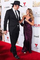 PASADENA, CA, USA - OCTOBER 10: Robert Rodriguez, Alexa PenaVega arrive at the 2014 NCLR ALMA Awards held at the Pasadena Civic Auditorium on October 10, 2014 in Pasadena, California, United States. (Photo by Celebrity Monitor)