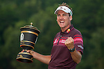 Ian Poulter poses with the trophy after winning the WGC HSBC Champions at the Mission Hills Resort on November 04, 2012, in Shenzhen China. Photo by Victor Fraile / The Power of Sport Images