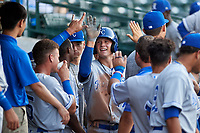 AZL Royals Bobby Witt, Jr. (17) celebrates with teammates after scoring a run during his professional debut in an Arizona League game against the AZL Cubs 1 on June 30, 2019 at Sloan Park in Mesa, Arizona. AZL Royals defeated the AZL Cubs 1 9-5. (Zachary Lucy / Four Seam Images)