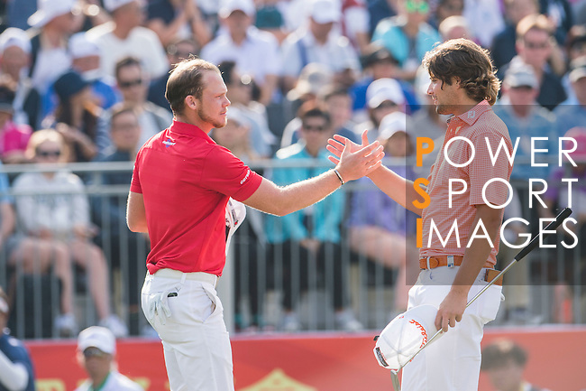 Danny Willett of England (in red) shakes hands with Peter Uihlein of USA (in pink) after finishing the tournament during the 58th UBS Hong Kong Golf Open as part of the European Tour on 11 December 2016, at the Hong Kong Golf Club, Fanling, Hong Kong, China. Photo by Marcio Rodrigo Machado / Power Sport Images