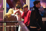 """© Joel Goodman - 07973 332324 . 16/12/2017. Manchester, UK. A man , believed to have been injured in a fight with another man , stems blood flowing from his nose . Revellers out in Manchester City Centre overnight during """" Mad Friday """" , named for historically being one of the busiest nights of the year for the emergency services in the UK . Photo credit : Joel Goodman"""