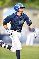 Asheville Tourists shortstop Jose Gomez (4) runs to first base during a game against the Greensboro Grasshoppers at McCormick Field on April 27, 2017 in Asheville, North Carolina. The Tourists defeated the Grasshoppers 8-5. (Tony Farlow/Four Seam Images)